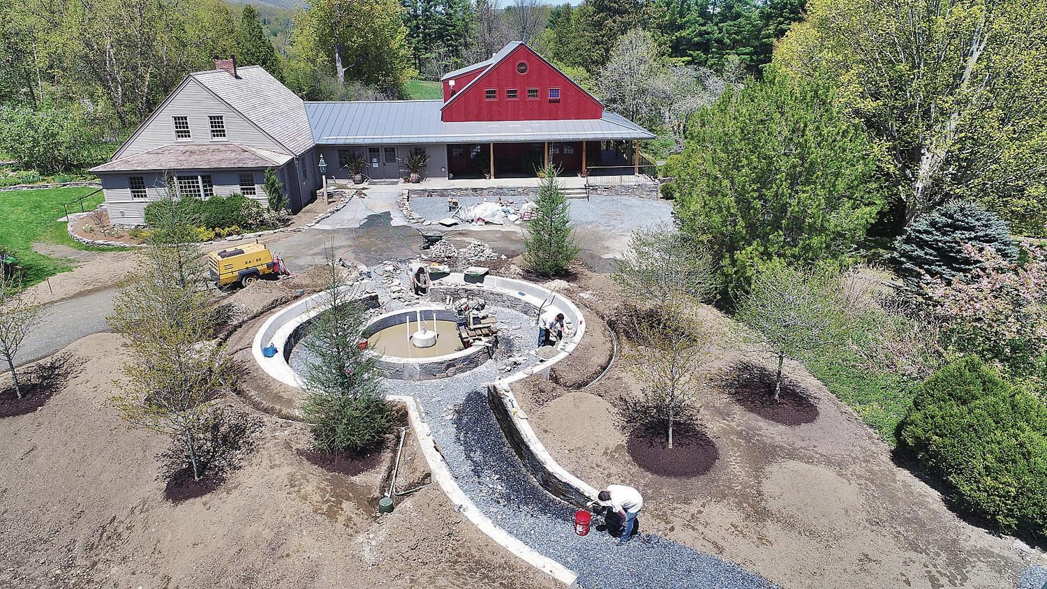 A Crew Works On A Fountain Structure In The Entrance Garden To The The  Newly Renovated And Expanded Center House, Home To Three Galleries  Featuring ...